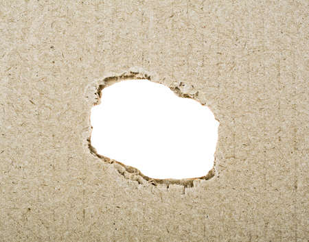 hole: Ragged hole in cardboard