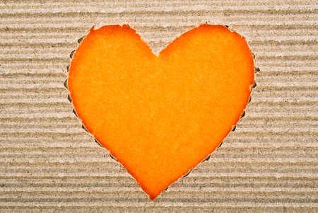 pasteboard: Orange heart cut from corrugated cardboard