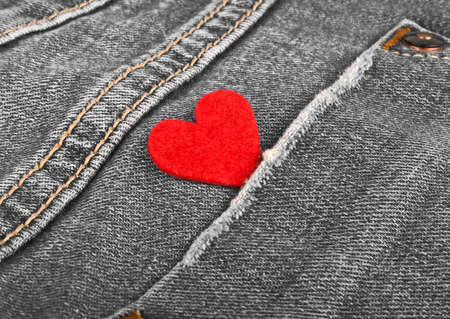 jeans pocket: Red heart in jeans pocket