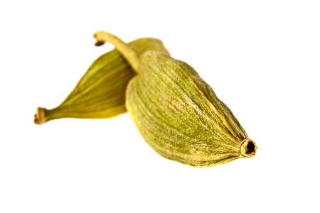 cardamon: Close up of cardamon pods on white background