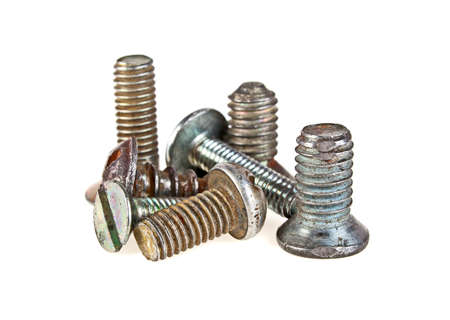 Various old screws on a white background Stock Photo