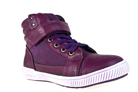 rubber sole: Violet children shoes for girls on a white background Stock Photo