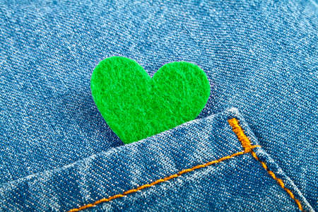 jeans pocket: Green heart in jeans pocket
