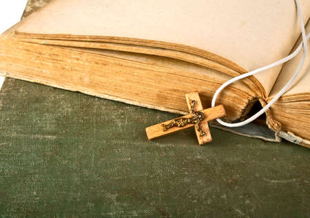 hymn: Closeup of simple wooden Christian cross on old books