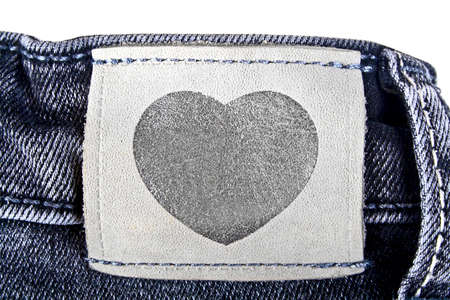 inner wear: Leather label in shape of heart sewed on jeans Stock Photo