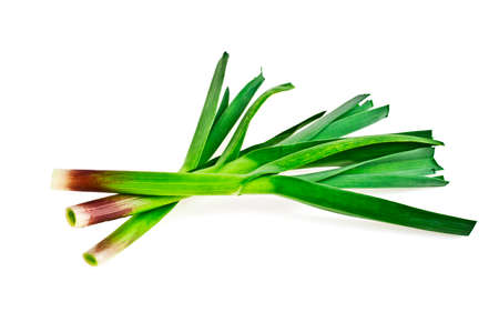 Young green garlic leaves isolated on a white background Stock Photo