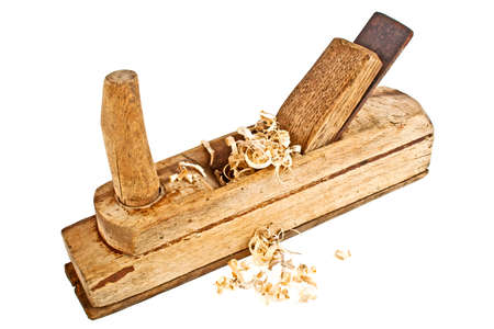 Old handed planer and wood shavings on a white background