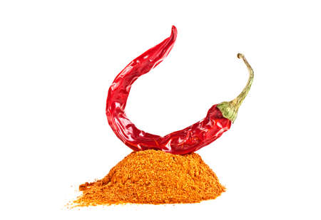 Red pepper with its powder on a white background Stock Photo