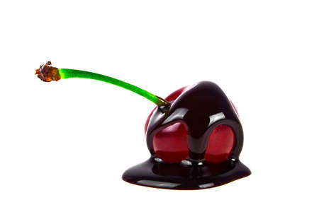 blanketed: Cherry in chocolate on a white background Stock Photo