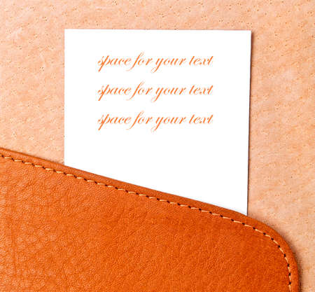 plain stitch: Sample business card in open leather holder, space for your text and image