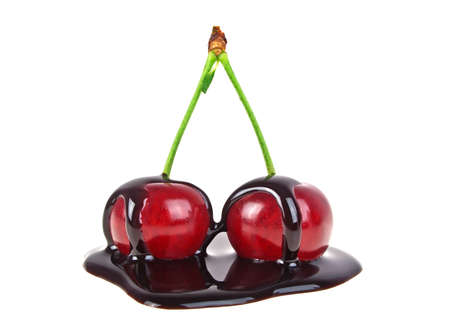 blanketed: Cherries in chocolate on a white background