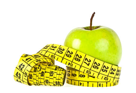 lose up: Green apple with measuring tape on white background