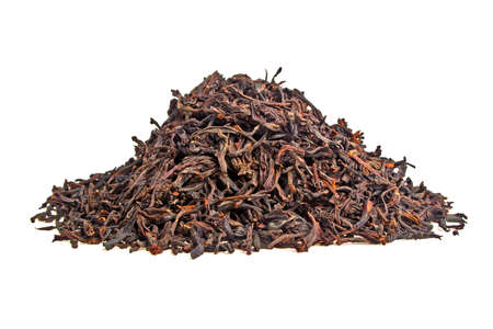 loose leaf: Dry black tea leaves isolated on white background