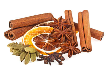 Anise, cardamom, carnation, dried orange and cinnamon sticks on a white background. Spices.