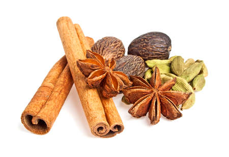 Anise, cardamom, nutmeg and cinnamon sticks on a white background. Spices.