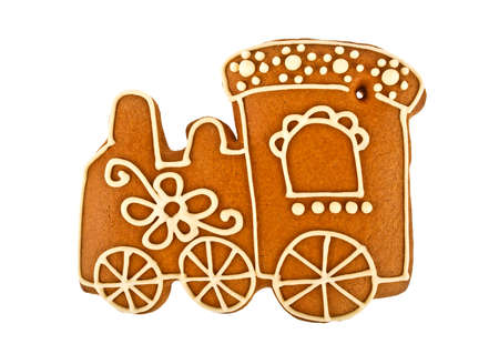 Gingerbread cookie in shape of train isolated on white background. Decorated homemade gingerbread cookies.