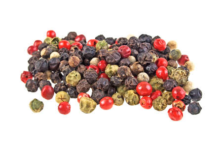 indian cookery: Heap of various pepper peppercorns seeds mix on white background
