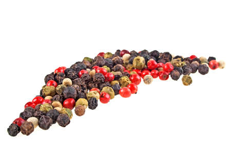 Heap of various pepper peppercorns seeds mix on white background