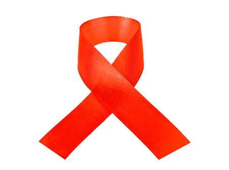 aids awareness ribbon: Red AIDS awareness ribbon isolated on white background