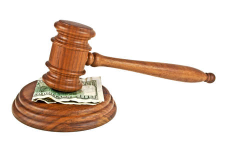 Wooden judge gavel and one hundred dollars isolated on white background