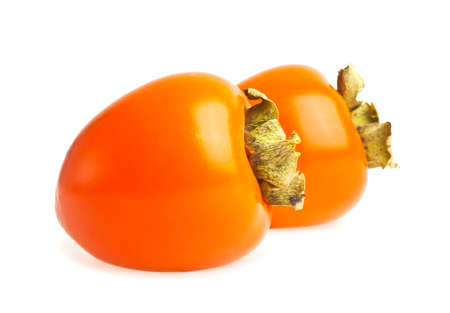 Ripe persimmons on white background Stock Photo