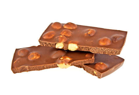 Milk chocolate with nuts on a white background, closeup