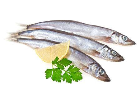 Capelin fish, lemon and parsley isolated on white background