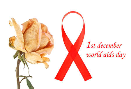 Aids awareness red ribbon and faded rose on white background, world aids day concept Stock Photo