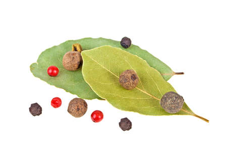 Dried bay laurel leaves and peppercorns isolated on a white background, close up Stock Photo