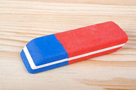 Eraser on wooden background