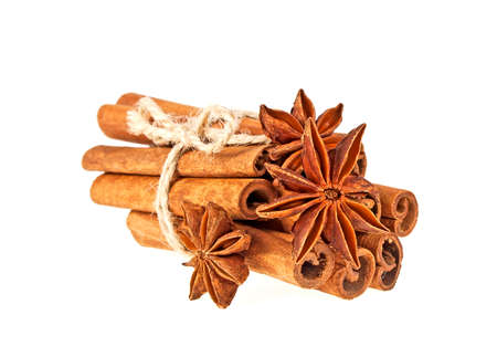 christmas scent: Anise and cinnamon sticks isolated on white background Stock Photo