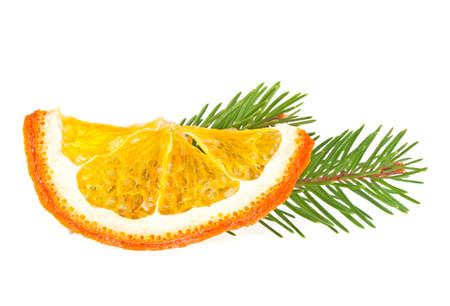 christmas scent: Dried slice of orange and fir tree on white background Stock Photo