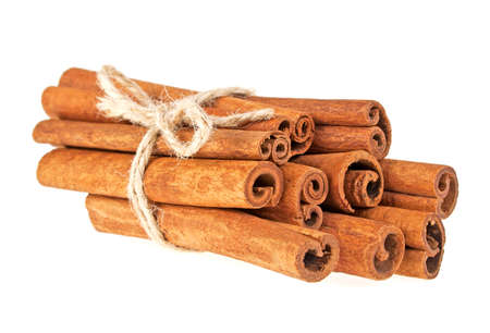 natural rope: Cinnamon sticks tied with a natural rope, isolated on white background Stock Photo
