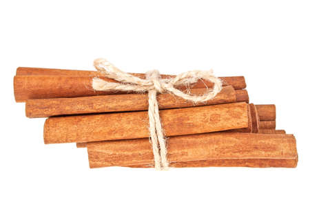 cannelle: Cinnamon sticks tied with a natural rope, isolated on white background Stock Photo
