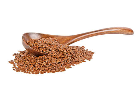 fatter: Flax seeds in wooden spoon isolated on white background Stock Photo