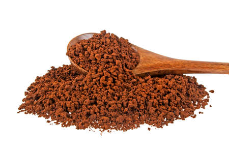 dissolve: Instant coffee grains in wooden spoon on a white background