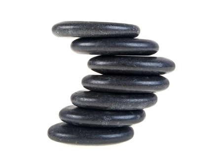 massage symbol: Black stones isolated on white background