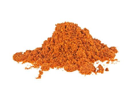 Pile of nutmeg powder isolated on white background