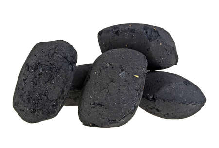 Charcoal briquettes on white background