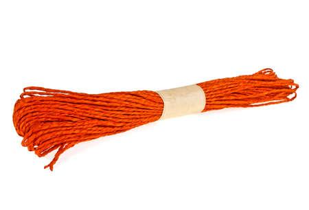 Orange raffia rope on a white background