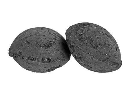 holzbriketts: Charcoal briquettes on white background