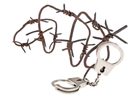 Rusty barbed wire and handcuffs on a white background