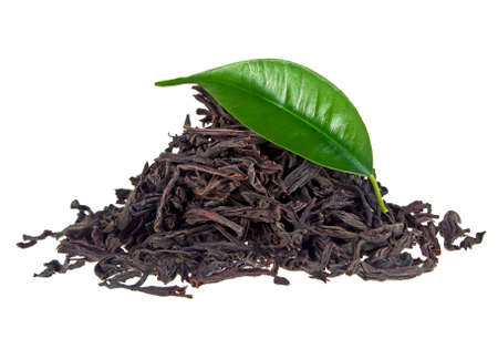 Black tea with leaf isolated on a white background