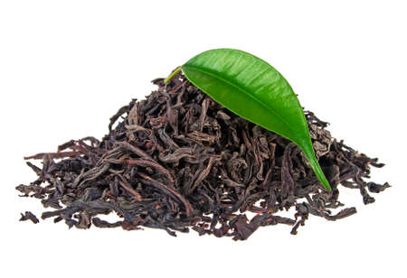 Heap of dry tea with green tea leaf isolated on a white background
