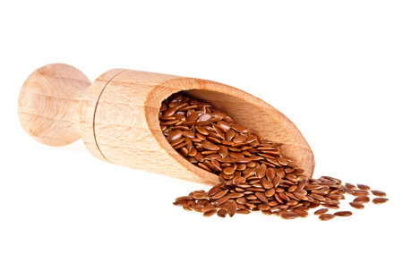 linum: Flax seeds in wooden scoop isolated on white background, close up