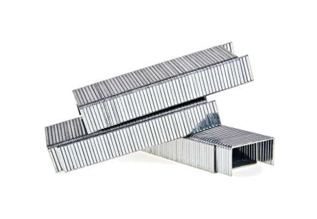 aluminium: Close up stack of metal staples for stapler on a white background