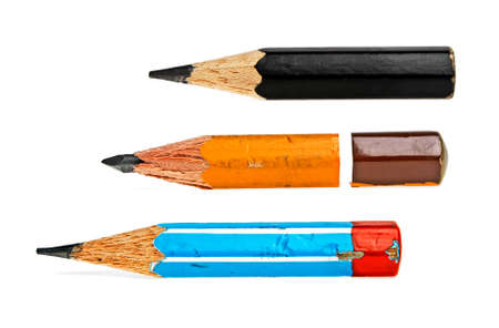 Old pencils on a white background