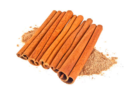 Cinnamon sticks with powder isolated on white background Stock Photo