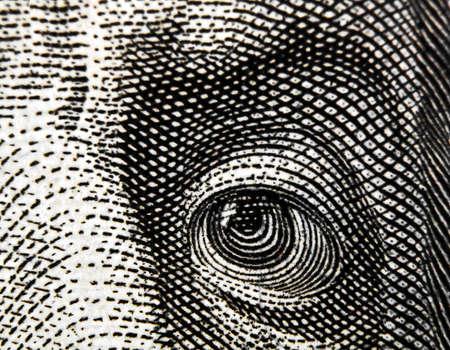 Fragment of $100 banknote. Eye.