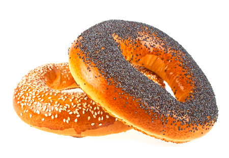 Tasty bagels with sesame and poppy seeds on a white background Imagens